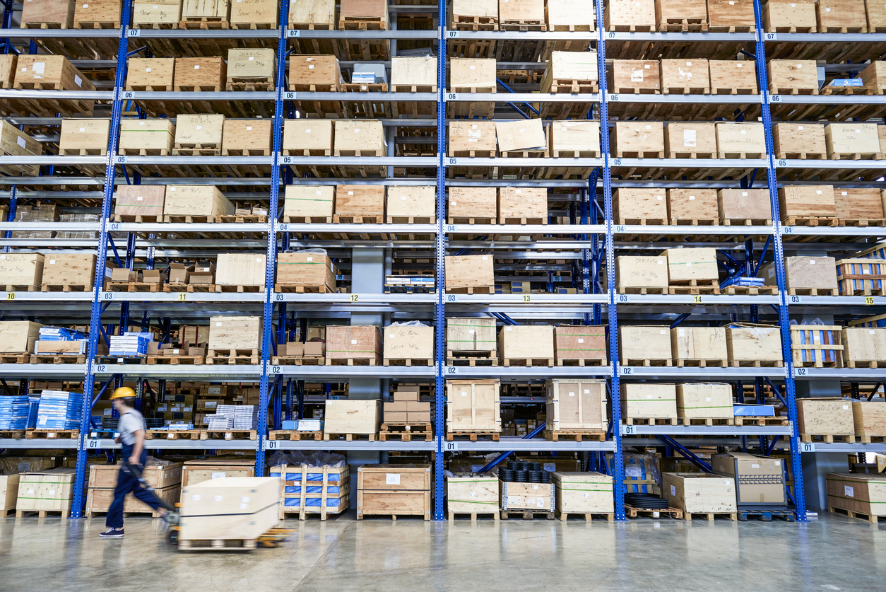 Cardboard boxes on shelves in warehouse. Storhouse.